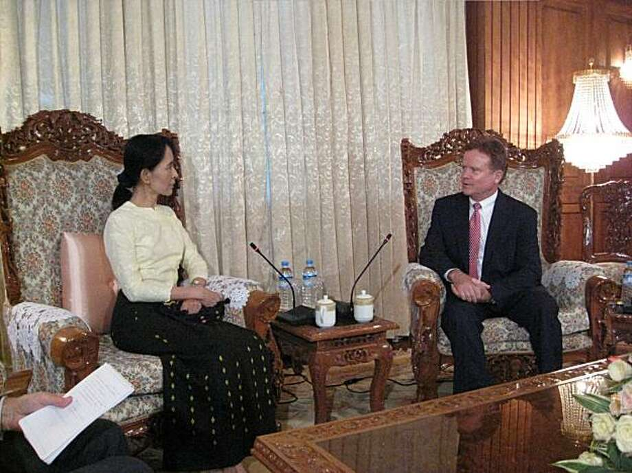 In this photo released by the office of U.S. Sen. Jim Webb, D-Va., Webb, right, meets with Myanmar's detained democracy leader Aung San Suu Kyi in Yangon, Myanmar, Saturday, Aug. 15, 2009.  Sen. Webb's office says he has won the release of an American prisoner in Myanmar. A statement Saturday said John Yettaw will be officially deported on Sunday afternoon when he will travel with Webb to Bangkok. Yettaw was convicted Tuesday of helping Suu Kyi violate the terms of her house arrest. (AP Photo/Office of Senator Jim Webb)  **EDITORIAL USE ONLY  ** Photo: Office Of Senator Jim Webb, AP