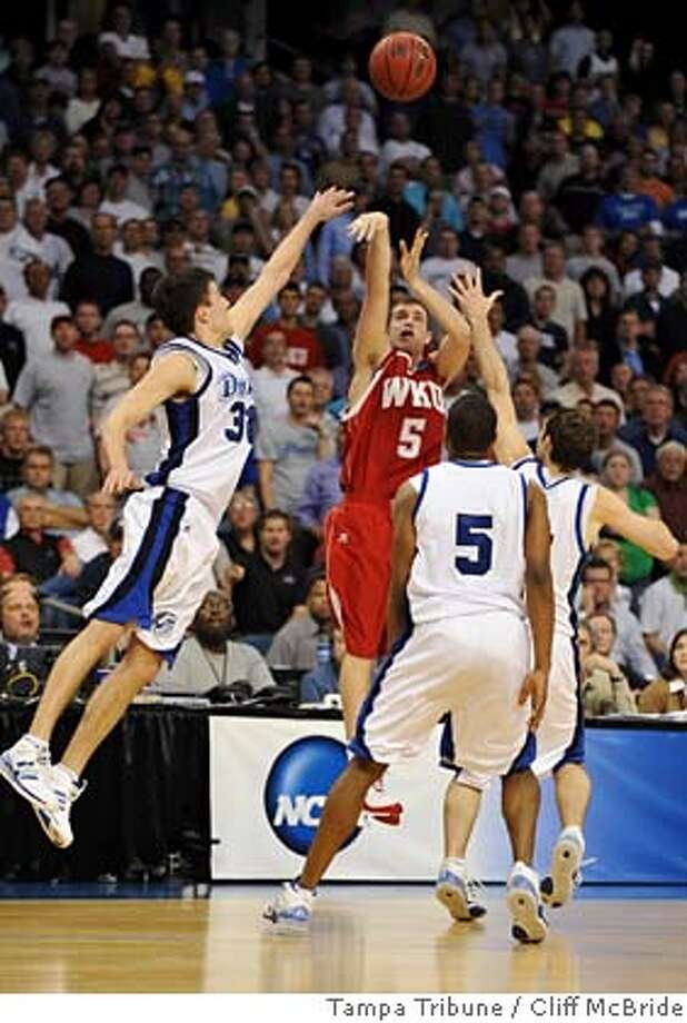 ###Live Caption:Western Kentucky's Ty Rogers (5) puts up the game-winning shot over Drake's Jonathan Cox (31),Leonard Houston (5) and another defender in overtime of an NCAA men's basketball tournament West Regional game Friday afternoon, March 21, 2008, in Tampa, Fla. Western Kentucky won 101-99. (AP Photo/Tampa Tribune, Cliff McBride) ** ST. PETERSBURG, LAKELAND, BRADENTON, AND WINTER HAVEN OUT MAGS OUT **###Caption History:Western Kentucky's Ty Rogers (5) puts up the game-winning shot over Drake's Jonathan Cox (31),Leonard Houston (5) and another defender in overtime of an NCAA men's basketball tournament West Regional game Friday afternoon, March 21, 2008, in Tampa, Fla. Western Kentucky won 101-99. (AP Photo/Tampa Tribune, Cliff McBride) ** ST. PETERSBURG, LAKELAND, BRADENTON, AND WINTER HAVEN OUT MAGS OUT **###Notes:Ty Rogers, Jonathan Cox, Leonard Houston###Special Instructions:ST. PETERSBURG, LAKELAND, BRADENTON, AND WINTER HAVEN OUT MAGS OUT EFE OUT Photo: Cliff McBride