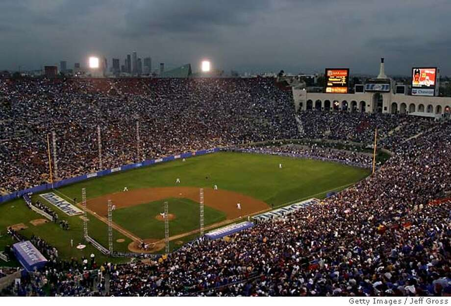 LOS ANGELES, CA - MARCH 29: A general view of the first pitch of the game between the Boston Red Sox and the Los Angeles Dodgers at the Memorial Coliseum March 29, 2008 in Los Angeles, California. (Photo by Jeff Gross/Getty Images)  Ran on: 03-30-2008  Over 115,000 fans pack into Memorial Coliseum, with its 201-foot left-field line, to watch the first pitch of the Dodgers-Red Sox exhibition. Photo: Jeff Gross