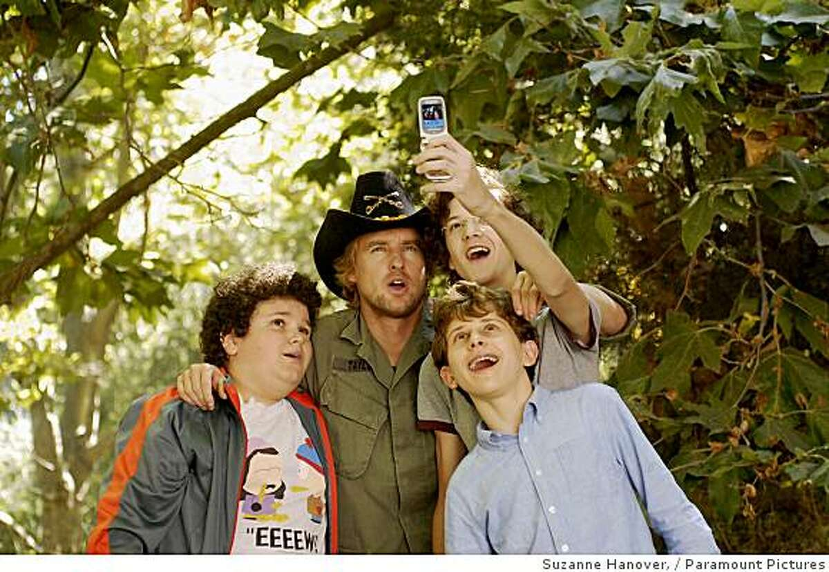 (Left to right) Ryan (Troy Gentile), Drillbit Taylor (Owen Wilson), Wade (Nate Hartley) and Emmit (David Dorfman) conspire to defeat a nasty school bully in Drillbit Taylor.