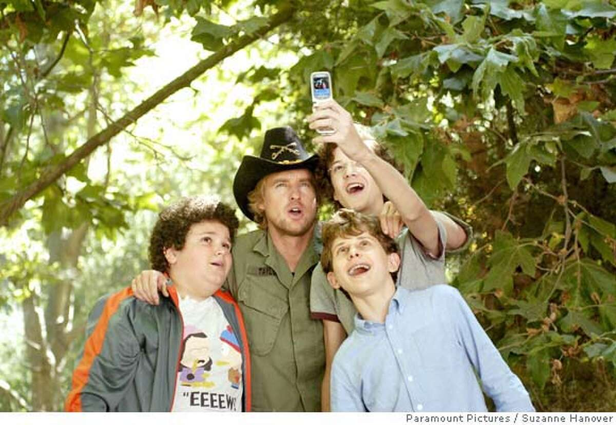 (Left to right) Ryan (Troy Gentile), Drillbit Taylor (Owen Wilson), Wade (Nate Hartley) and Emmit (David Dorfman) conspire to defeat a nasty school bully in Drillbit Taylor. Paramount Pictures Presents An Apatow/Roth/Arnold Production A Steven Brill Film Drillbit Taylor starring Owen Wilson, Leslie Mann, Danny McBride and Josh Peck. The film is directed by Steven Brill from a screenplay by Kristofor Brown & Seth Rogen. The story is by Edmond Dantes and Kristofor Brown & Seth Rogen. The producers are Judd Apatow, Susan Arnold and Donna Arkoff Roth. The executive producer is Richard Vane. This film has been rated PG-13 for crude sexual references throughout, strong bullying, language, drug references and partial nudity. Photo Credit: Suzanne Hanover