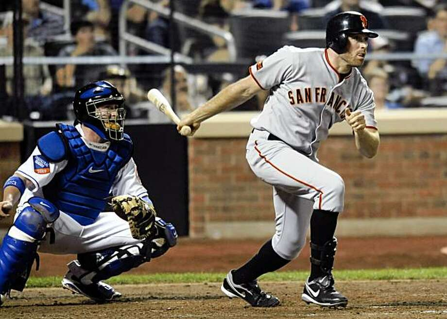 San Francisco Giants' Nate Schierholtz, right, drives in two runs with a pinch-hit double in the sixth inning against the New York Mets at Citi Field in New York, Monday, Aug. 17, 2009. Mets catcher Brian Schneider is at left. (AP Photo/Henny Ray Abrams) Photo: Henny Ray Abrams, AP