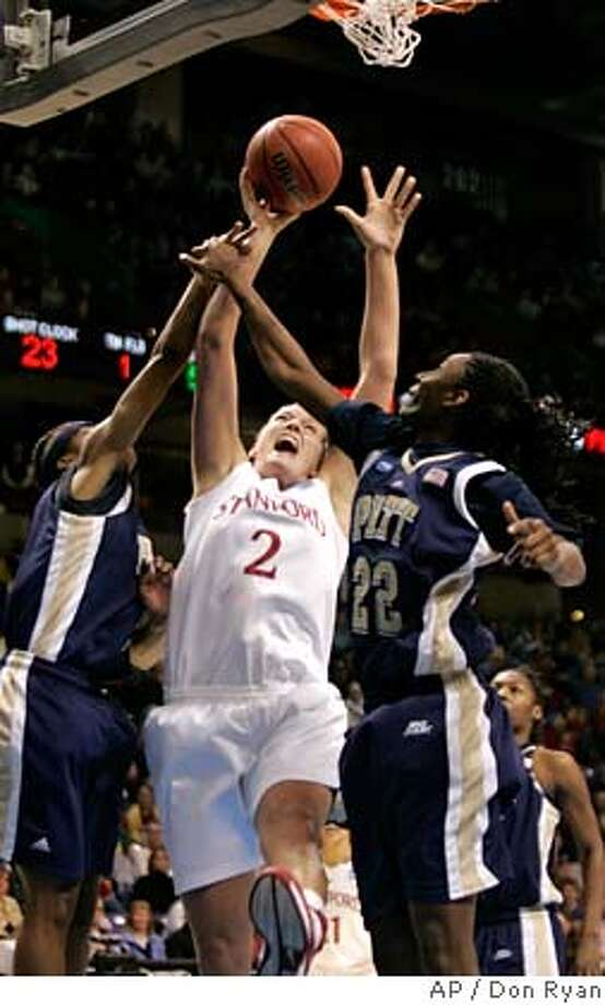 Stanford center Jayne Appel, middle, shoots against Pittsburgh's Chelsea Cole, right, and Shavonte Zellous during the first half of an NCAA women's basketball Spokane Regional tournament semifinal in Spokane, Wash., Saturday, March 29, 2008. (AP Photo/Don Ryan) Photo: Don Ryan