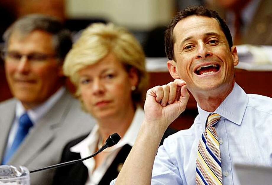 "WASHINGTON - JULY 30:  (R-L) U.S. Rep. Anthony Weiner (D-NY) speaks as Rep. Tammy Baldwin (D-WI) and Rep. Jay Inslee (D-WA) listen during a mark up hearing on the health care bill before the House Energy and Commerce Committee on Capitol Hill July 30, 2009 in Washington, DC. The committee has resumed its mark up hearing on the bill after reaching a deal with the ""Blue Dog Democrats"" to provide lower cost plans for small businesses. President Obama has predicted that the votes on the bill for both houses of the Congress would not happen until September, 2009.  (Photo by Alex Wong/Getty Images) Photo: Alex Wong, Getty Images"