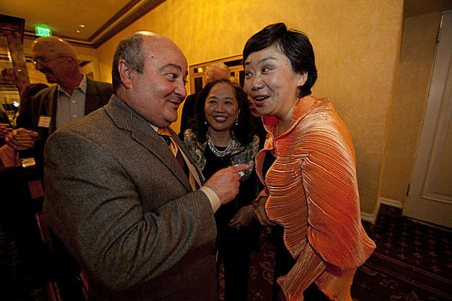 Zheng Cao, a star with the San Francisco Opera (R) shares a laugh with her Oncologist, Dr. Thierry Jahan and Jean Wang before singing at the opening night of the International Lung Cancer Conference gala at the Fairmont Hotel July 29, 2009 in San Francisco, Calif.  (Photograph by David Paul Morris Special to the Chronicle) Photo: David Paul Morris, Special To The Chronicle