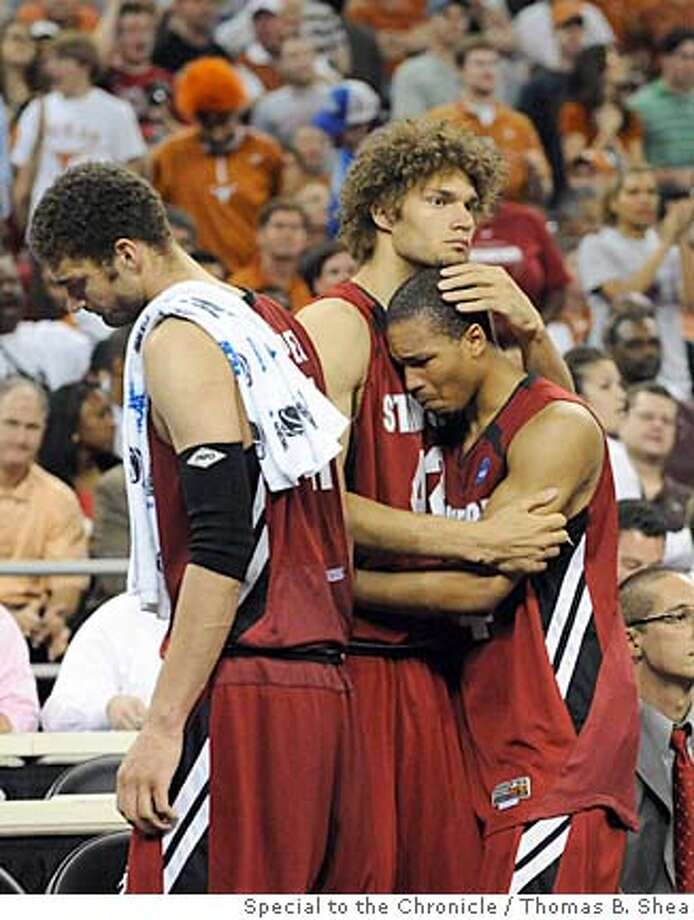 3/28/2008 : Stanford Cardinal Robin Lopez (44) hugs Fred Washington (44) after losing to the Texas Longhorns in the first round of the sweet 16 NCAA Championship at Reliant Stadium in Houston, Texas. Final score was 82-62 Longhorns. Photo by Thomas B. Shea / Special to the Chronicle Ran on: 03-29-2008  Stanford's Robin Lopez (left) hugs teammate Fred Washington after the Cardinal lost 82-62 to Texas on Friday, ending Stanford's season. Eight teams remain in the NCAA men's basketball tournament, a.k.a. March Madness, which continues tonight, and all four regional top seeds -- Memphis, Kansas, UCLA and North Carolina -- are still alive, as is the year's Cinderella story, Davidson. For complete coverage, see Sports, Page D1  Ran on: 03-29-2008 Photo: Thomas B. Shea
