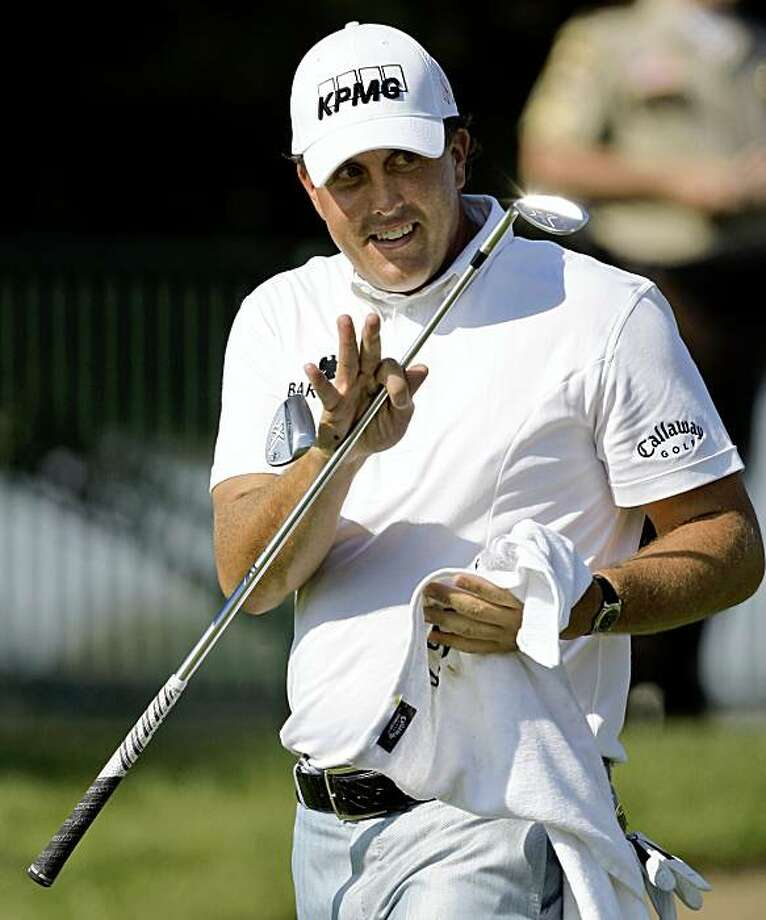 Phil Mickelson waves to spectators during a practice round for the 91st PGA Championship at the Hazeltine National Golf Club in Chaska, Minn., Wednesday, Aug. 12, 2009. (AP Photo/Charles Neibergall) Photo: Charles Neibergall, AP