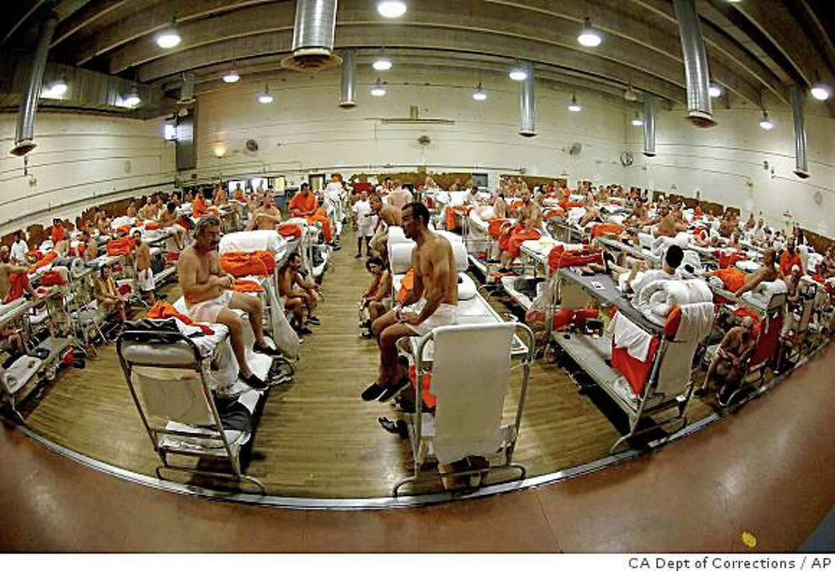 **FILE** In this undated file photo released by the California Department of Corrections, inmates sit in crowded conditions at the California Institute for Men in Chino, Calif. A special panel of federal judges tentatively ruled Monday, Feb. 9, 2009, that California must release tens of thousands of inmates to relieve overcrowding. The judges said no other solution will improve conditions so poor that inmates die regularly of suicides or lack of proper care. (AP Photo/California Department of Corrections)