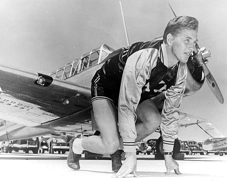 Kjell Qvale poses next to an airplane in Corpus Christi, Texas, where he was in military training for the navy, circa 1941 Photo: The Kjell Qvale Collection