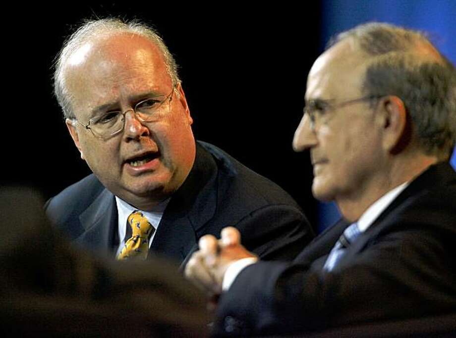 Former White House Chief of Staff Karl Rove left, and former U.S. Senate Majority Leader George Mitchell discuss politics and the economy at the Mortgage Bankers Association's annual convention at Moscone West Convention Center in San Francisco, Calif., on Tuesday, Oct. 21, 2008. Photo: Kim Komenich, The Chronicle