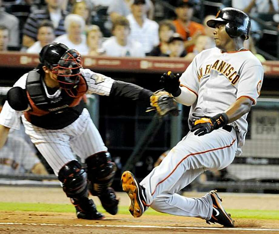 San Francisco Giants' Edgar Renteria, right, is tagged out by Houston Astros catcher Ivan Rodriguez after trying to score from second base on a Eugenio Velez hit in the second inning of a baseball game Monday, Aug. 3, 2009 in Houston. (AP Photo/Pat Sullivan) Photo: Pat Sullivan, AP