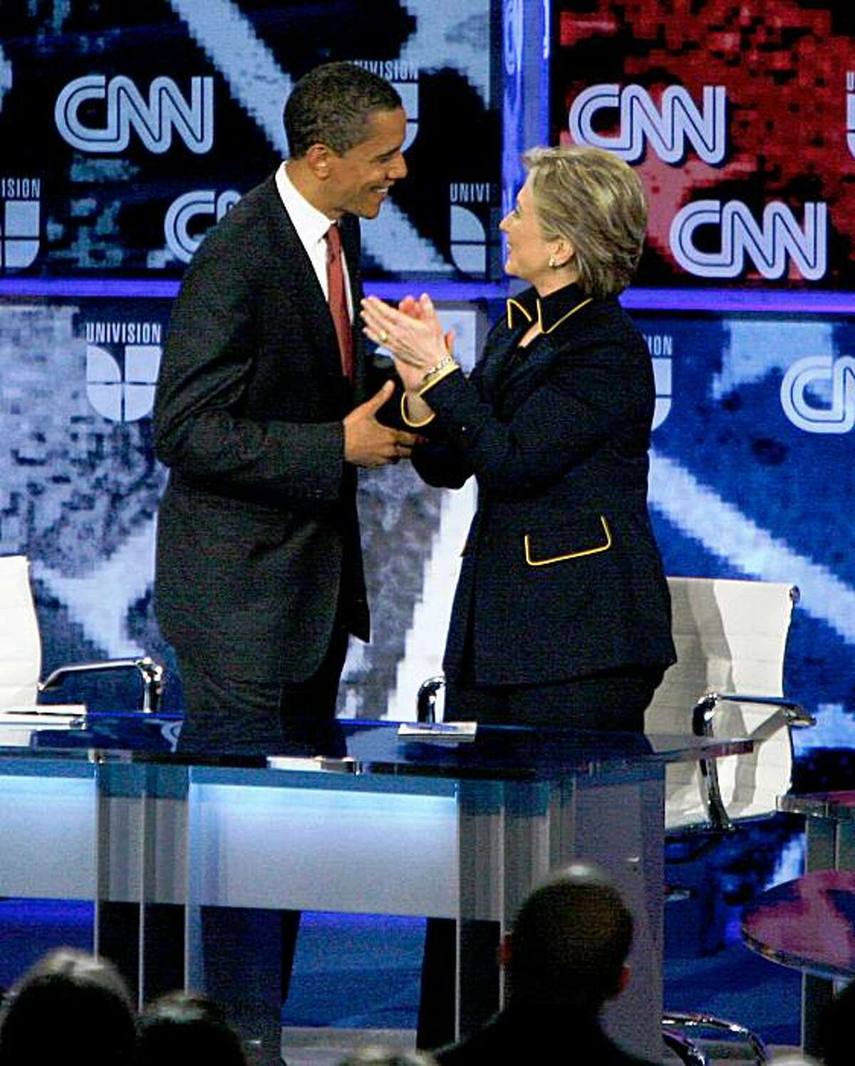 AUSTIN, TX - FEBRUARY 21: Democratic presidential hopefuls U.S. Sen. Barack Obama (D-IL) and U.S. Sen. Hillary Clinton (D-NY) speak after participating in a debate Lyndon B. Johnson Auditorium at the University of Texas on February 21, 2008 in Austin, Texas. The debate was sponsored by the Texas Democratic Party, Univision and CNN and was ahead of the Texas and Ohio primaries being held on March 4th. (Photo by Ben Sklar/Getty Images)