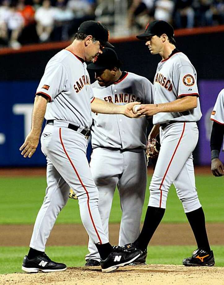 San Francisco Giants Barry Zito, right, hands the ball to manager Bruce Bochy as he leaves the game against the New York Mets in the sixth inning of their baseball game at Citi Field in New York, Friday, Aug. 14, 2009. (AP Photo/Ed Betz) Photo: Ed Betz, AP