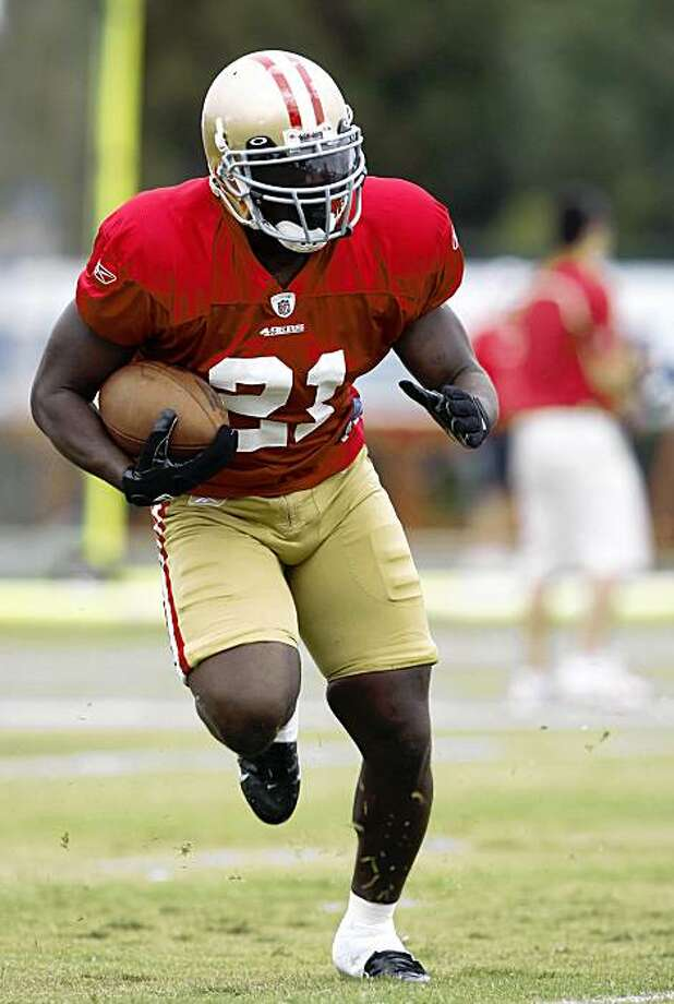 San Francisco 49ers running back Frank Gore runs during NFL football training camp in Santa Clara, Calif., Saturday, Aug. 1, 2009. (AP Photo/Marcio Jose Sanchez) Photo: Marcio Jose Sanchez, AP