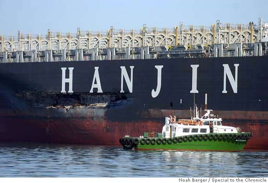 ###Live Caption:An approximately 90-foot long gash stretches down the Cosco Busan's hull as it rests at anchor on Tuesday, Nov. 13, 2007, in the San Francisco Bay, Calif. The vessel struck the Bay Bridge last Wednesday spilling about 58,000 gallons of oil into the bay. BY NOAH BERGER/SPECIAL TO THE CHRONICLE. EDITOR: DO NOT RELEASE TO ANY WIRE OR OTHER NEWSPAPER. CHRONICLE USE ONLY.###Caption History:busan_nb4  An approximately 90-foot long gash stretches down the Cosco Busan's hull as it rests at anchor on Tuesday, Nov. 13, 2007, in the San Francisco Bay, Calif. The vessel struck the Bay Bridge last Wednesday spilling about 58,000 gallons of oil into the bay.  BY NOAH BERGER/SPECIAL TO THE CHRONICLE.  EDITOR: DO NOT RELEASE TO ANY WIRE OR OTHER NEWSPAPER. CHRONICLE USE ONLY.###Notes:###Special Instructions: Photo: Noah Berger