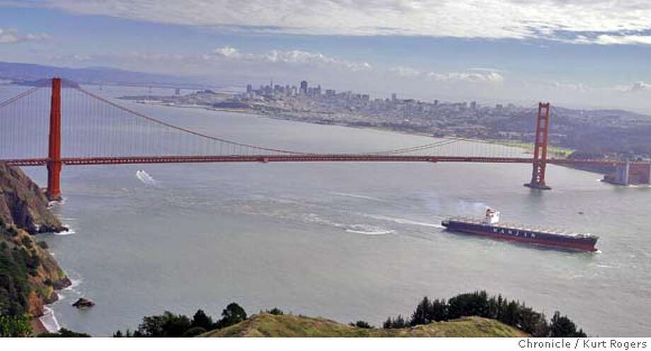 The Cosco Busan heads out under the Golden Gate Bridge.  The Cosco Busan sails out of San Francisco Bay today after it hit the Bay Bridge on Nov 7th spilling 58,000 gallons of bunker oil into the bay.  SPILL_SHIP_0090_KR.jpg  Kurt Rogers / The Chronicle Photo taken on 12/20/07, in San Francisco, CA, USA Photo: Kurt Rogers