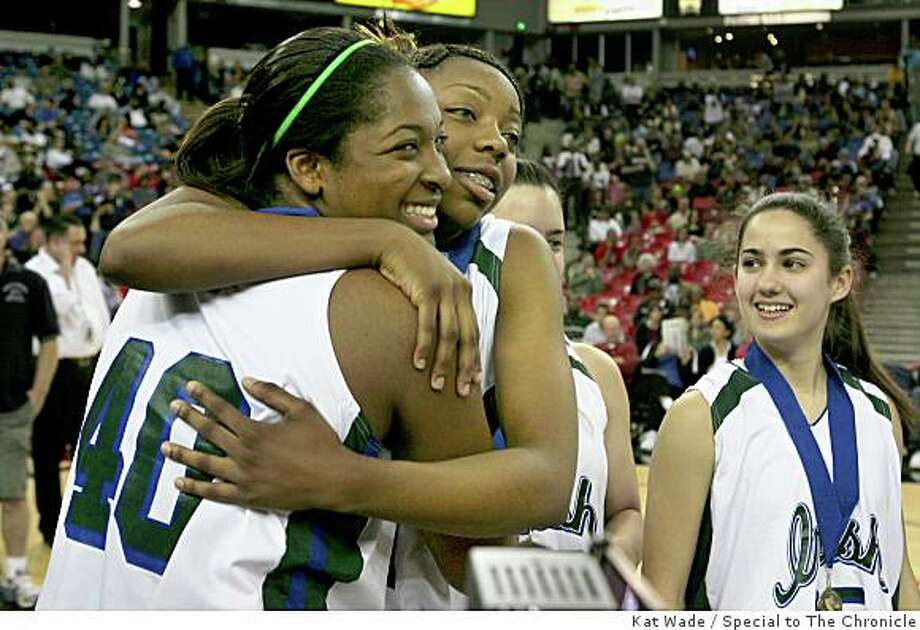 Sacred Heart Cathedral Fightin' Irish high scorer Kamilah Jackson, left,   gets a hug from Tierra Rogers  while teammate Kirsten Michler  looks on after winning the Girls Division III State Championship against the Magnolia Sentinels 48 to 33 at the ARCO arena in Sacramento, Calif. on Sunday, March 16, 2008.Photo by Kat Wade / Special to the Chronicle Photo: Kat Wade, Special To The Chronicle