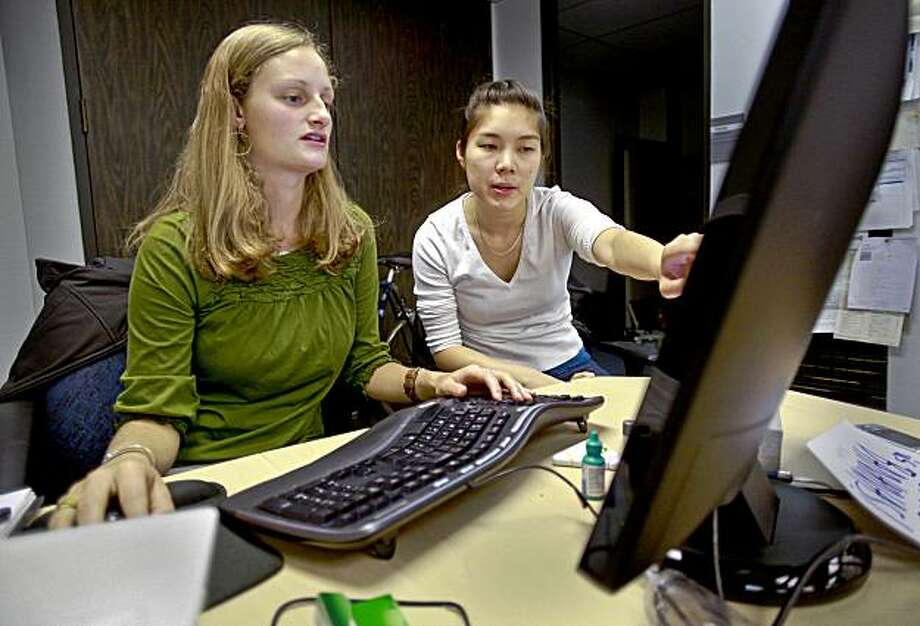 2008 college graduate, Dana Lin, (right) on Thursday July 23, 2009 in San Francisco, Calif., at Bright Green Talent, where Lin is taking an unpaid internship, after she was laid off from her job in Silicon Valley. Carolyn Mansfield, (left) is currently a full time employee at the company who also volunteered after college graduation at the start up to get her foot in the door. Photo: Michael Macor, The Chronicle