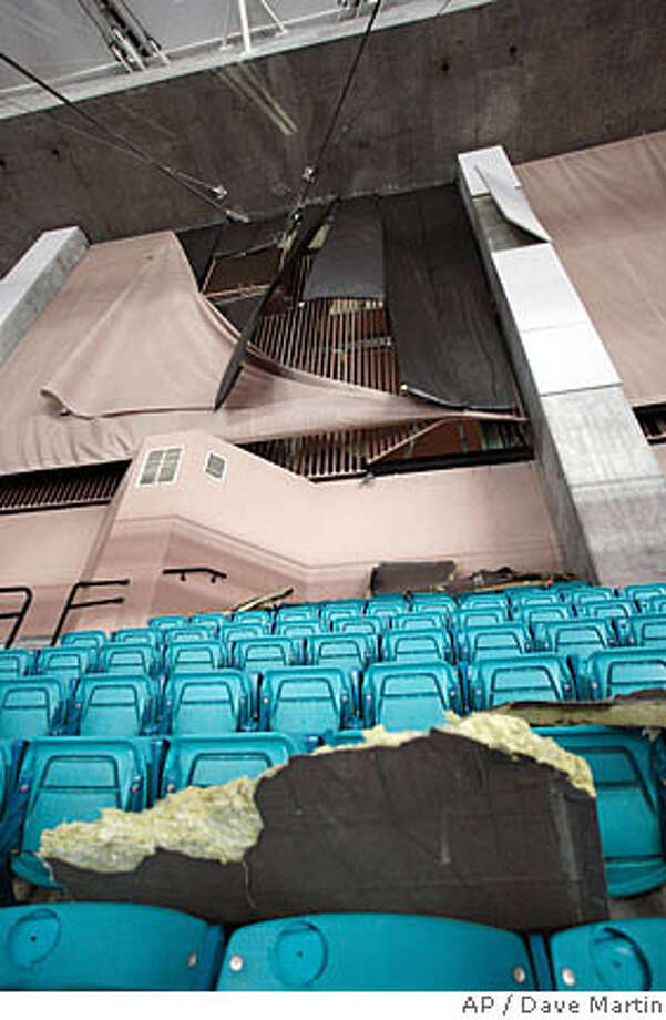 Debris lies in the seats of the upper section of the Georgia Dome after a severe storm blew in several sections of the wall above, dropping debris into the seats and damaging the facility and surrounding buildings. The storm caused a delay in the Alabama-Mississippi State basketball game during the Southeastern Conference basketball tournament in the Georgia Dome in Atlanta Friday, March 14, 2008. (AP Photo/Dave Martin) Photo: Dave Martin