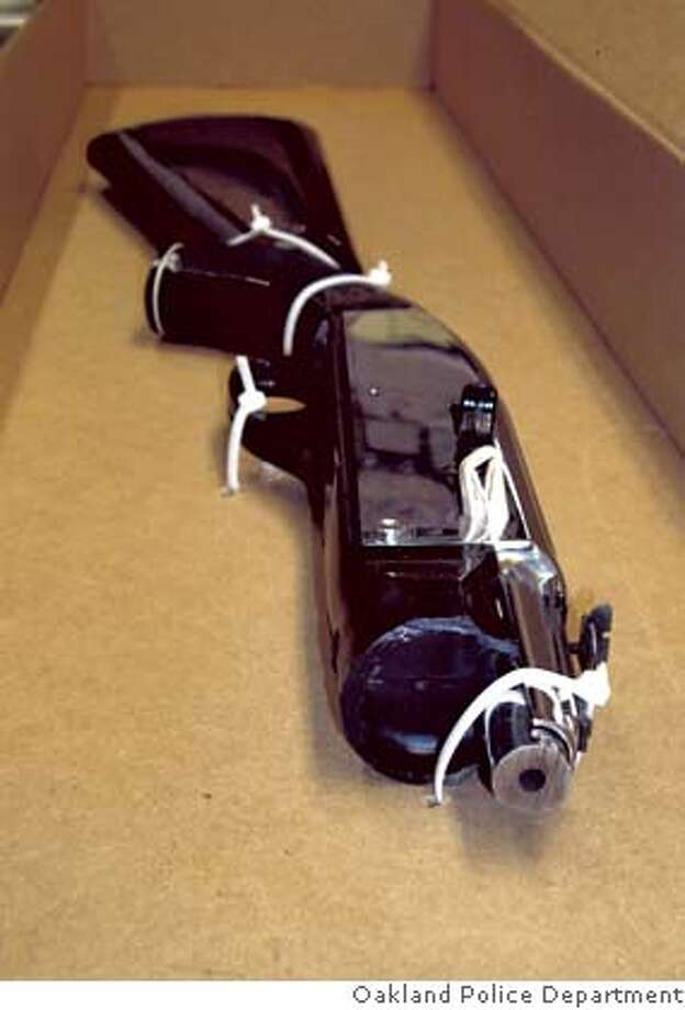 ###Live Caption:The sawed-off rifle that Oakland police say 15-year-old Jose  Luis Buenrostro pointed at three gang unit officers right before they shot him to death in Oakland, Calif., on March 18, 2006. Photo Courtesy of the Oakland Police Department###Caption History:The sawed-off rifle that Oakland police say 15-year-old Jose  Luis Buenrostro pointed at three gang unit officers right before they  shot him to death in Oakland, Calif., on March 18, 2006. Photo Courtesy of the Oakland Police Department###Notes:Undated handout picture.###Special Instructions:MANDATORY CREDIT FOR PHOTOG AND SAN FRANCISCO CHRONICLE/NO SALES-MAGS OUT Photo: Oakland Police Department