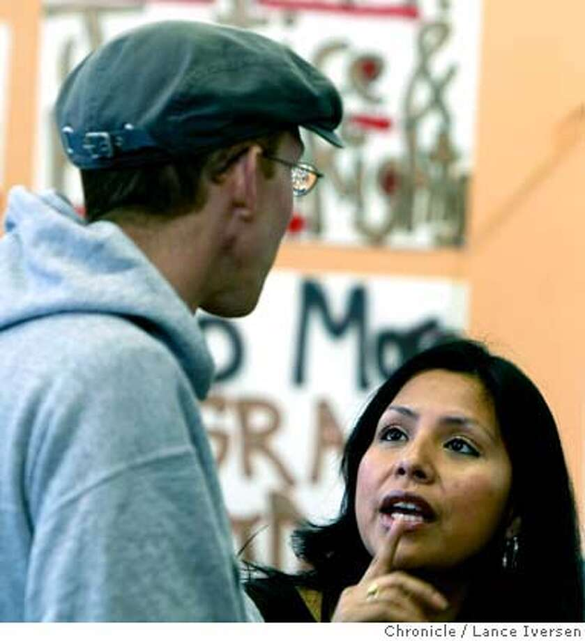 Laura Perez Director of Street Level Health Project in Oakland's Fruitvale neighborhood chats with a volunteer requesting that he look for housing for an unemployed patient of the clinic that's undergone recent surgery. By Lance Iversen/The Chronicle Photo: Lance Iversen