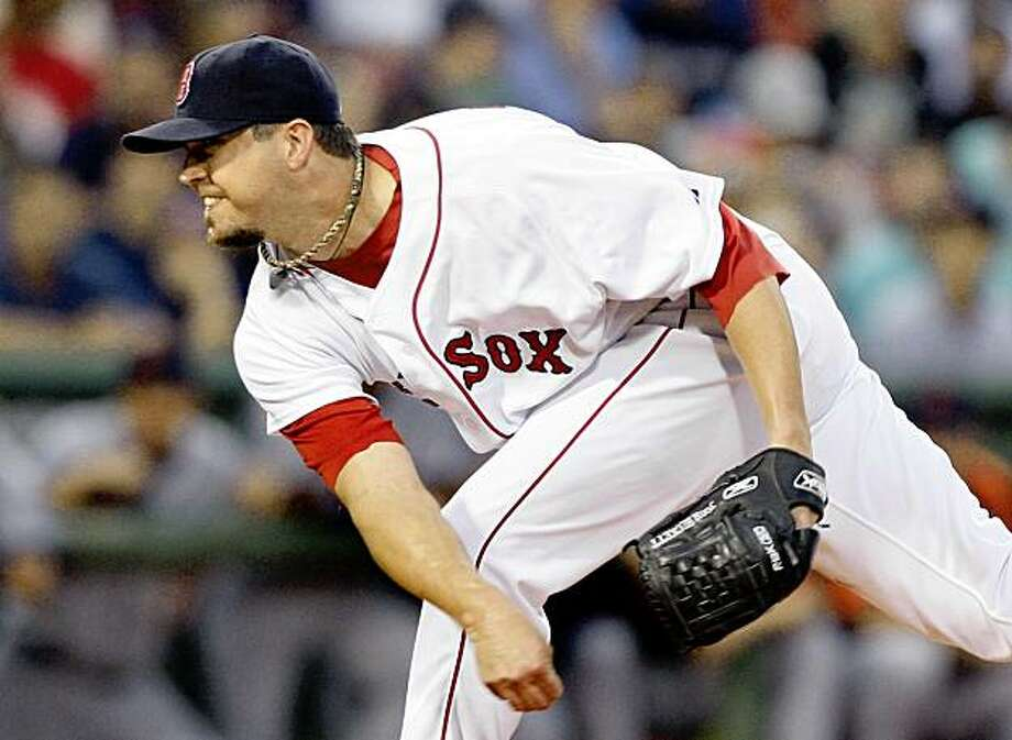 Boston Red Sox starter Josh Beckett pitches to the Detroit Tigers in the first inning of a baseball game at Fenway Park in Boston, Wednesday, Aug. 12, 2009. (AP Photo/Elise Amendola) Photo: Elise Amendola, AP