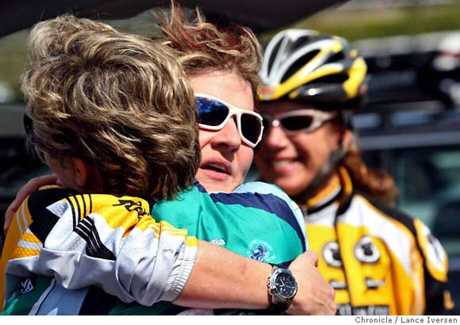 Renee Beckloff from San Francisco a member of the Roaring Mouse Cycles (facing camera) gets a hug from Pat Baenen from Portola Valley. Friends and relatives of the two bicyclists killed in last Sunday's crash in the Cupertino hills, returned to the crash site Saturday March 15, 2008, to honor the memory of both victims, Kristy Gough was a member of Pillar Cycles and Matt Peterson was a member of Roaring Mouse Cycles club. Hundreds made the ride on bikes from Los Altos up to Stevens Canyon Boulevard in Cupertino with a Sheriff's escort. Photographed in Cupertino Saturday March 15, 2008, Photo By Lance Iversen / San Francisco Chronicle. Photo: LANCE IVERSEN