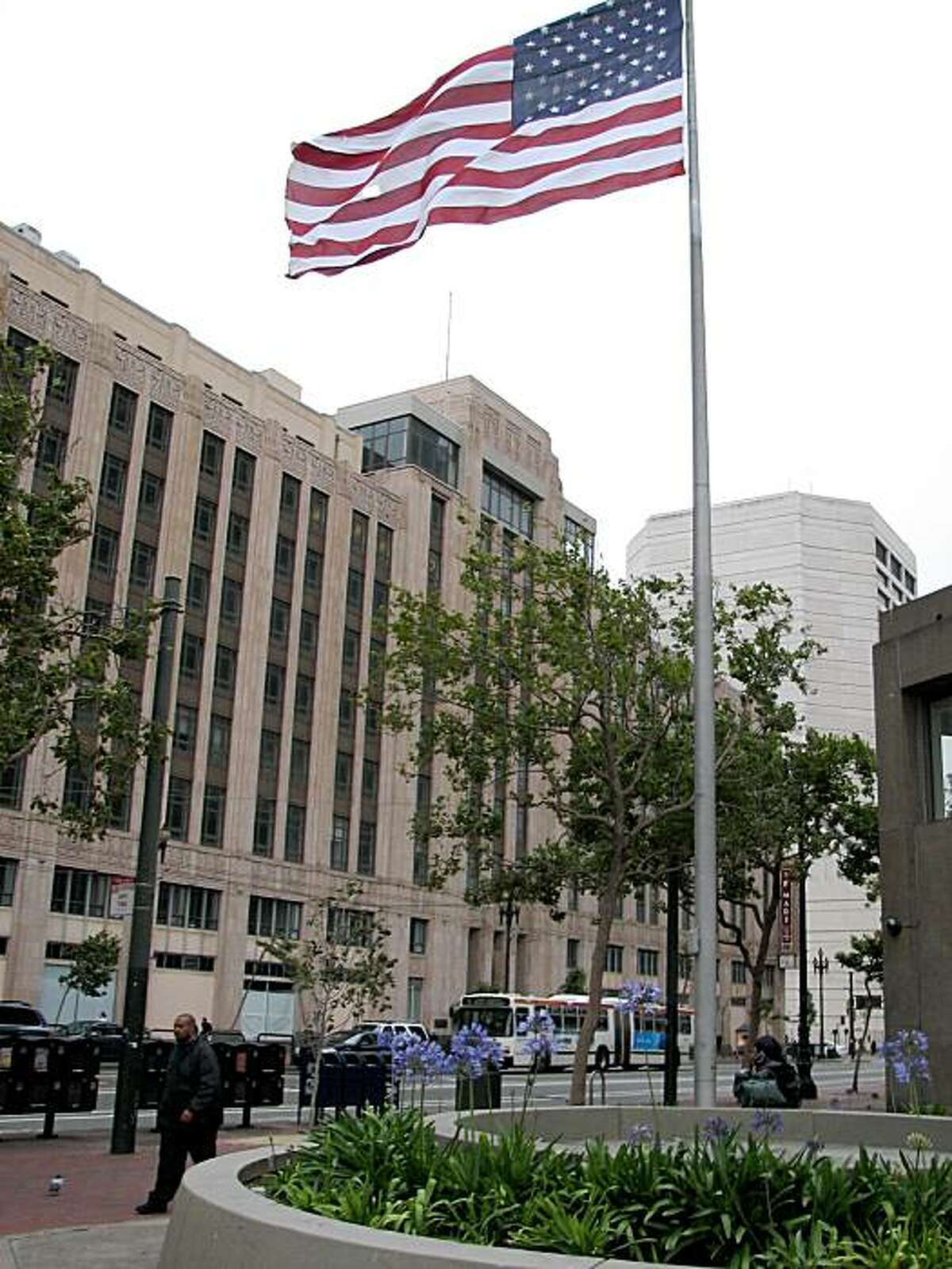 Flag in frnot of u.s. post office at 9th and market