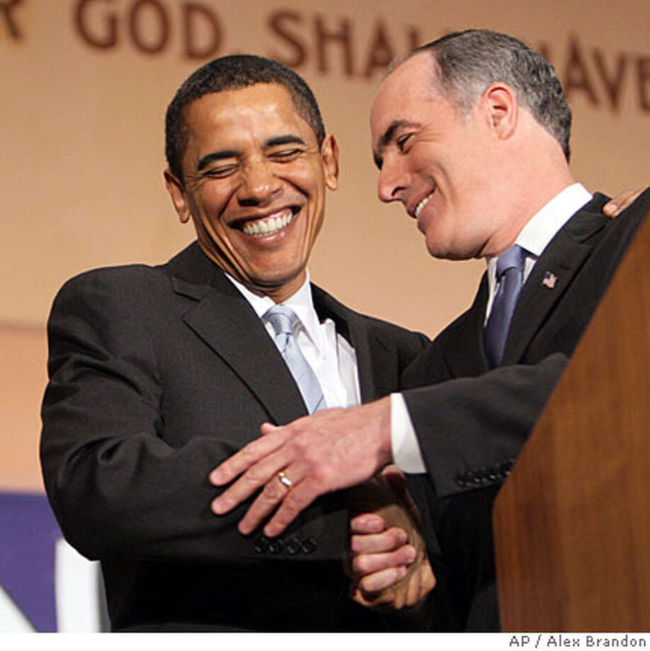 Democratic presidential hopeful Sen. Barack Obama D-Ill., left, laughs with Sen. Bob Casey Jr., D-Pa., Friday, March 28, 2008, at the Soldiers and Sailors Museum and Memorial in Pittsburgh, Pa. where Casey announced his endorsement of Obama. (AP Photo/Alex Brandon) Photo: Alex Brandon