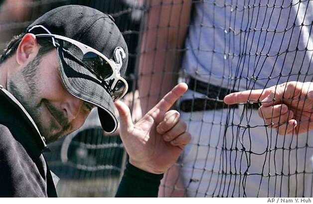 ###Live Caption:Chicago White Sox's Nick Swisher talks to a fan before a spring training baseball game against the Oakland Athletics on Friday, March 14, 2008, in Tucson, Ariz. The Athletics won 8-1. (AP Photo/Nam Y. Huh)###Caption History:Chicago White Sox's Nick Swisher talks to a fan before a spring training baseball game against the Oakland Athletics on Friday, March 14, 2008, in Tucson, Ariz. The Athletics won 8-1. (AP Photo/Nam Y. Huh)###Notes:Nick Swisher###Special Instructions:EFE OUT Photo: Nam Y. Huh