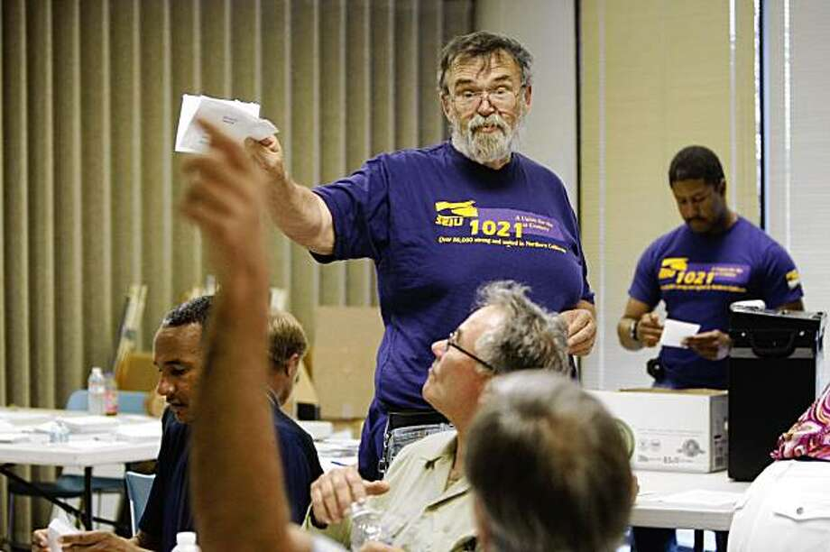 At the SEIU regional headquarters in Oakland, Henry Harper counts ballots to ratify a new contract for roughly 1,400 BART employees on Monday Aug. 10, 2009 in Oakland, Calif. Photo: Mike Kepka, The Chronicle