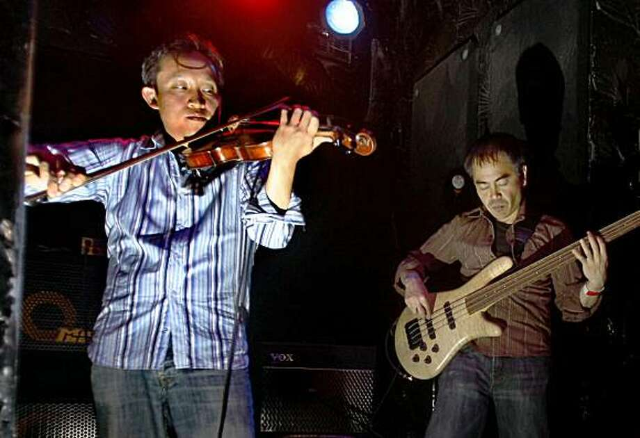 David Chiu, president of SF Board of Supervisors, who is also a classically trained violinist, playing with Lumaya, an alternative rock band playing at the Red Devil Lounge in San Francisco, Calif.,  on Friday, July 24, 2009. Photo: Liz Hafalia, The Chronicle