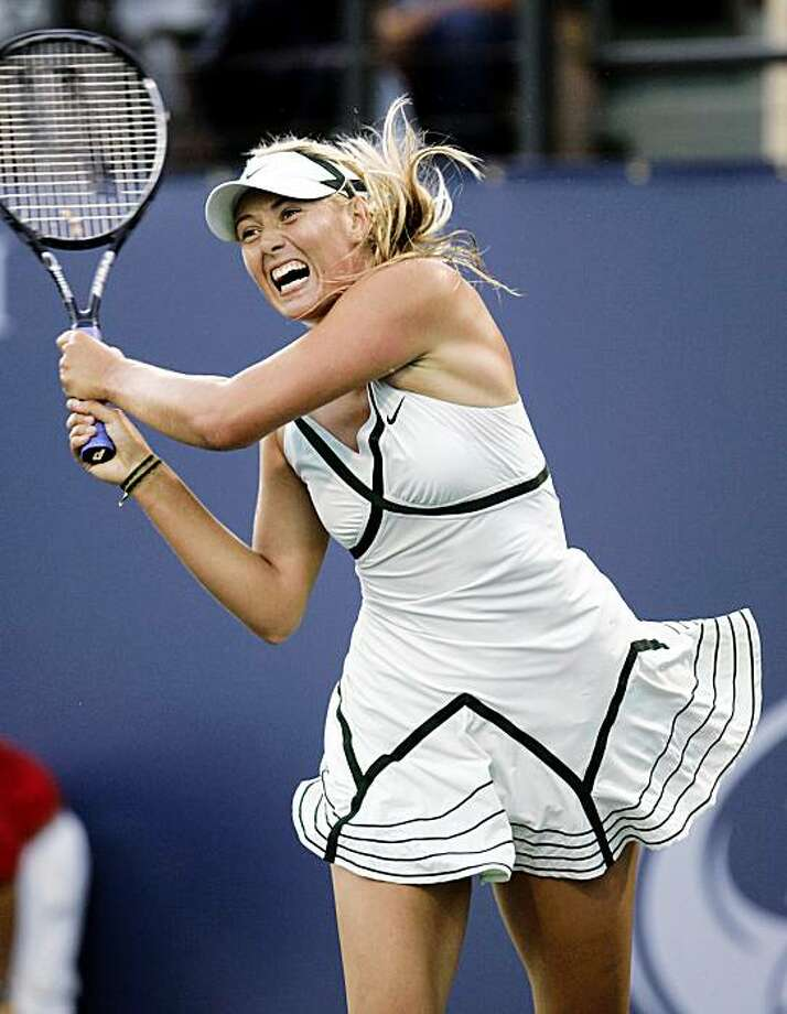 Maria Sharapova, of Russia, returns a shot against Ai Sugiyama, of Japan, in the Bank of the West tennis tournament in Stanford, Calif., Monday, July 27, 2009. (AP Photo/Paul Sakuma) Photo: Paul Sakuma, AP