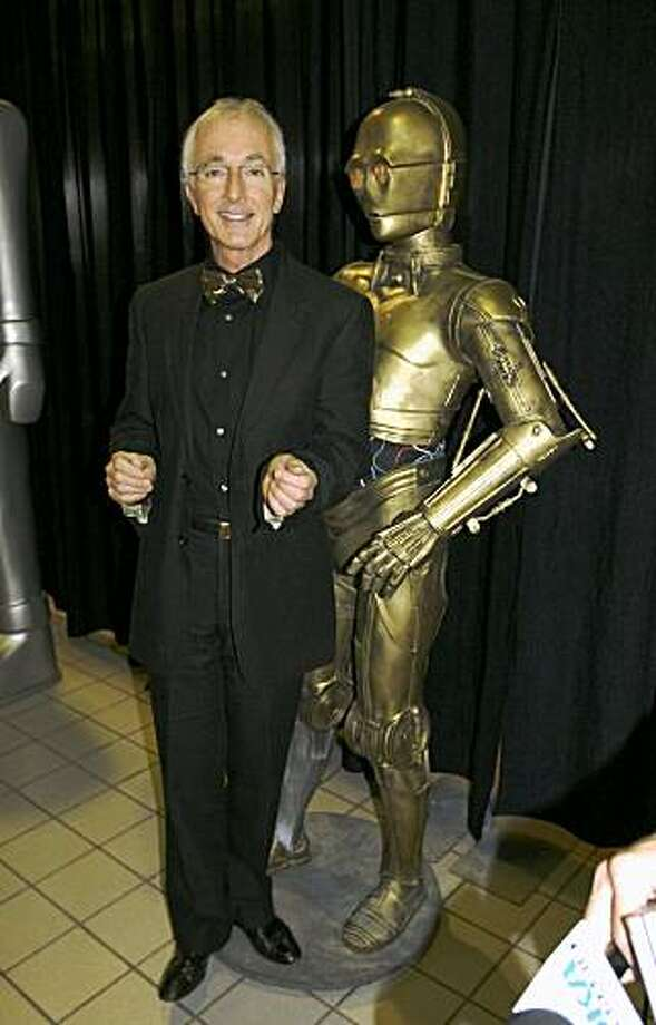 "FILE - In this April 9, 2008 file photo, Anthony Daniels, a British actor who played C-3PO in all six ""Star Wars"" movies, poses with a model of the fictional robot at the Carnegie Science Center in Pittsburgh  (AP Photo/Daniel Lovering, file) Photo: Daniel Lovering, AP"