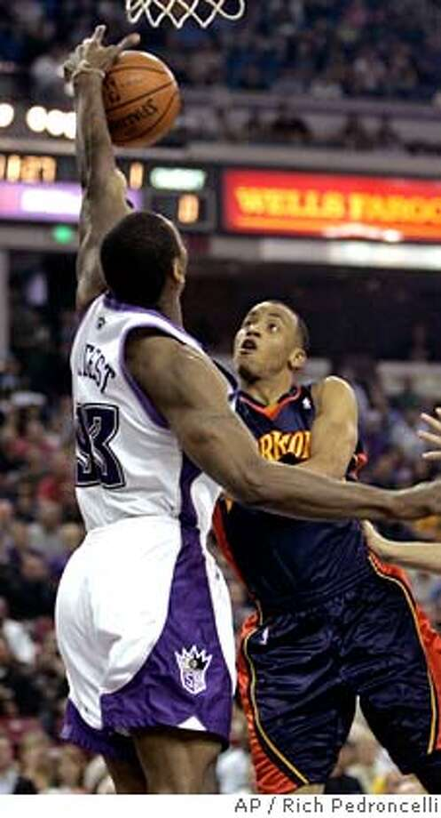 ###Live Caption:Sacramento Kings forward Ron Artest, left, blocks the shot of Golden State Warriors guard Monta Ellis, right, during the first quarter of an NBA basketball game in Sacramento, Calif., Tuesday, March 18, 2008. (AP Photo/Rich Pedroncelli)###Caption History:Sacramento Kings forward Ron Artest, left, blocks the shot of Golden State Warriors guard Monta Ellis, right, during the first quarter of an NBA basketball game in Sacramento, Calif., Tuesday, March 18, 2008. (AP Photo/Rich Pedroncelli)###Notes:Ron Artest, Monta Ellis###Special Instructions:EFE OUT Photo: Rich Pedroncelli