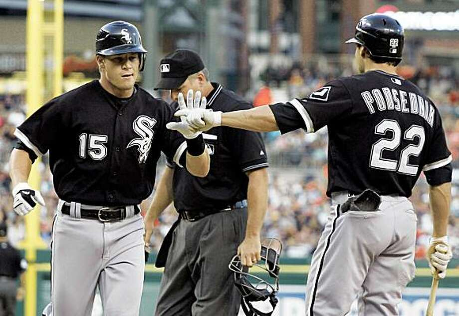 Chicago White Sox's Gordon Beckham (15) is congratulated by Scott Podsednik (22) after hitting a solo home run in the second inning of a baseball game against the Detroit Tigers on Sunday, July 26, 2009, in Detroit. (AP Photo/Duane Burleson) Photo: Duane Burleson, AP