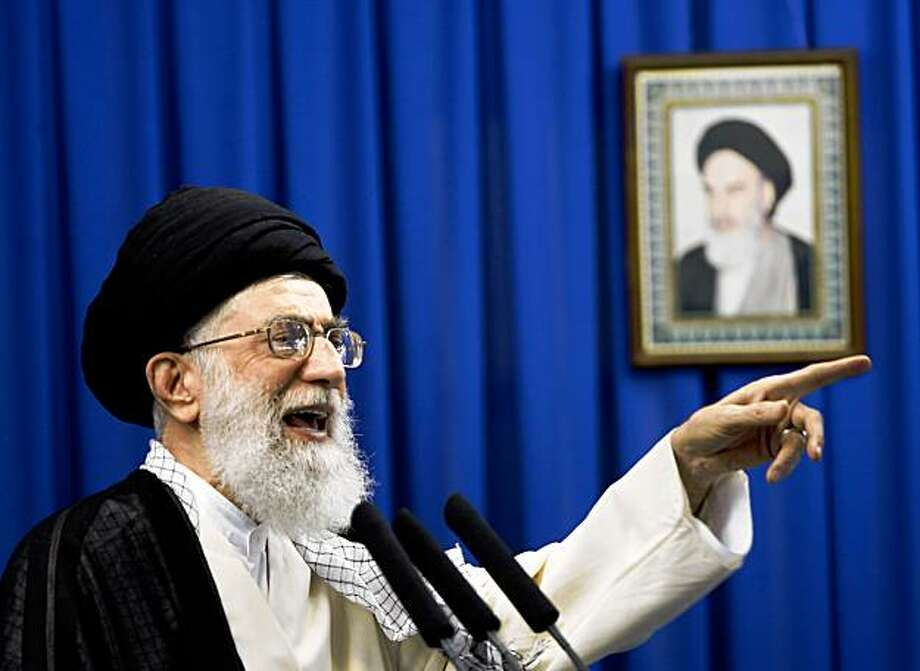 (FILES) -- File picture dated September 19, 2008 shows Iran's supreme leader Ayatollah Ali Khamenei delivering the Friday prayer sermon, with a portrait of the late founder of Islamic Republic Ayatollah Ruhollah Khomeini in the background, at Tehran university. In a condolence message broadcast on state television, Khamenei accused on April 25, 2009 Iran's archfoes, Washington and Israel, over a suicide killing in Iraq which left scores of Iranians dead, local media reported. At least 140 people have been killed, including more than 70 Iranian pilgrims, within 24 hours as suicide attackers targeted areas packed with civilians in Baghdad and a restaurant northeast of the Iraqi capital.  AFP PHOTO/BEHROUZ MEHRI (Photo credit should read BEHROUZ MEHRI/AFP/Getty Images) Photo: Behrouz Mehri, AFP/Getty Images