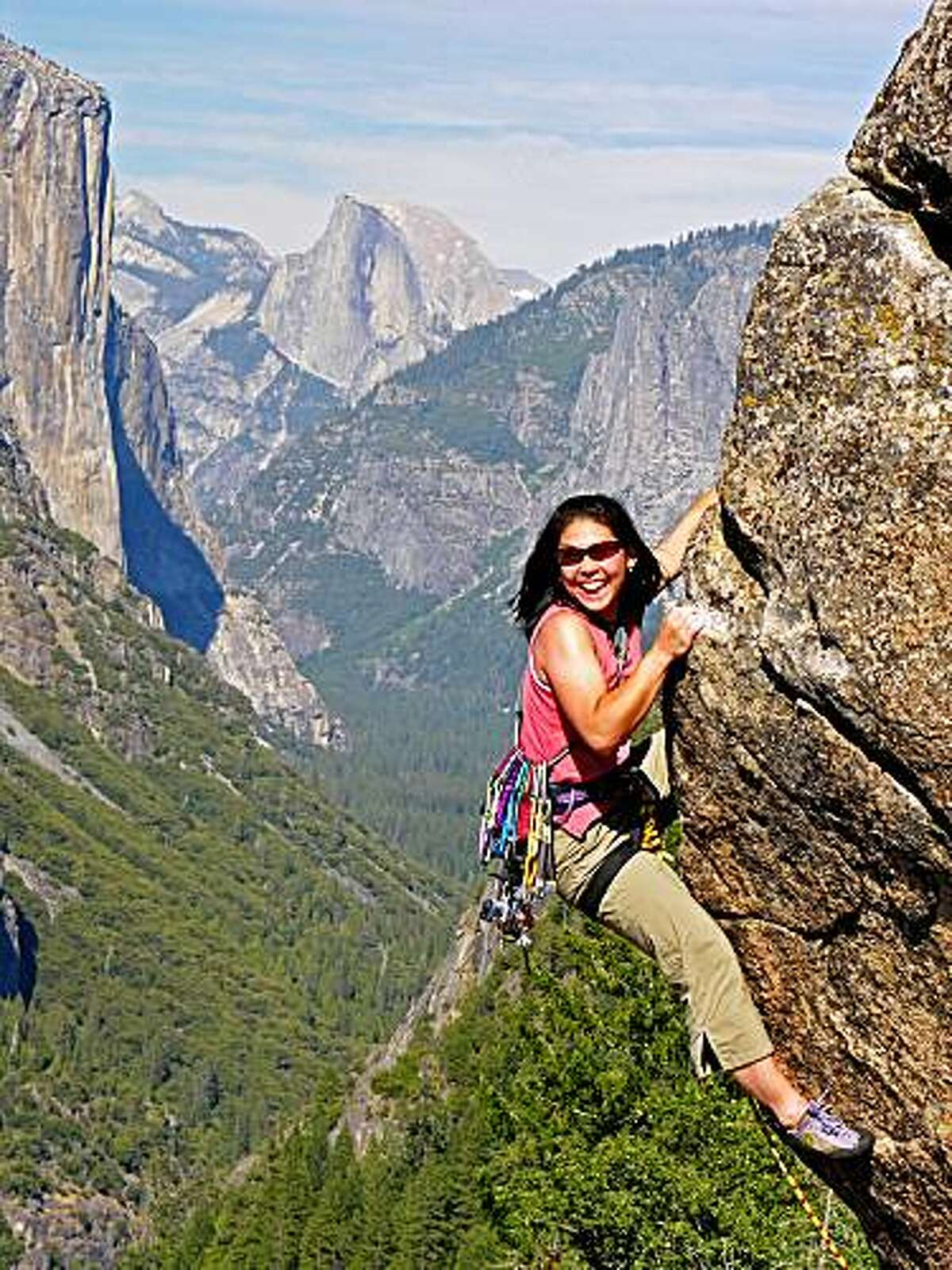 Theresa Ho worked at the Yosemite Mountaineering School before she was badly injured while hiking in the park two years ago. In this photo, she's climbing Yosemite's Turtleback Dome. El Capitan is on the left, and Half Dome is in the background.