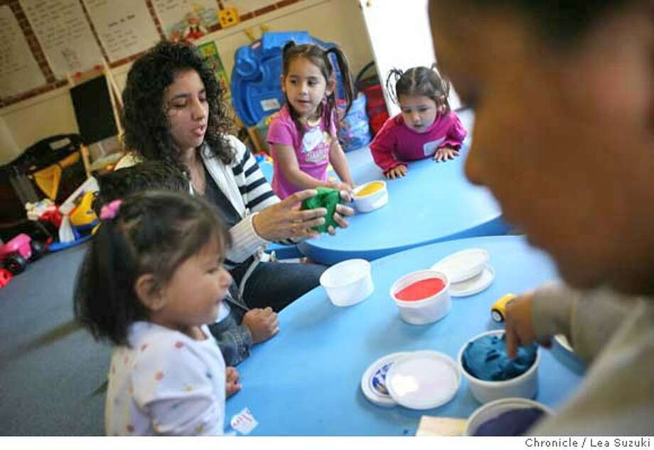 "###Live Caption:Veronica Vega (upper left in striped sweater) Coordinator at Mujeres Unidas y Activas helps children in the childcare room with play-doh while some of their mothers attend a healthy parenting class at the offices of Mujeres Unidas y Activas on Monday March 10, 2008 in Oakland. In immigrant communities across Calfornia, grassroots networks of volunteer ""promotores,"" or health promoters, are teaching their neighbors how to manage diabetes, practice safe sex, cope with stress and find an affordable doctor. The volunteers are welcomed in Latino communities, because their approach is familiar, but it's also taking hold among Russian, Mongolian and Hmong immigrant groups and others who have trouble navigating the American health system. The work of the promotores is being embraced by county health departments and even health maintenance organizations because itÕs an inexpensive way of getting urgent health information out to a tough-to-reach audience, much of it un-insured. Photo by Lea Suzuki / San Francisco Chronicle###Caption History:Veronica Vega (upper left in striped sweater) Coordinator at Mujeres Unidas y Activas helps children in the childcare room with play-doh while some of their mothers attend a healthy parenting class at the offices of Mujeres Unidas y Activas on Monday March 10, 2008 in Oakland. In immigrant communities across Calfornia, grassroots networks of volunteer ""promotores,"" or health promoters, are teaching their neighbors how to manage diabetes, practice safe sex, cope with stress and find an affordable doctor. The volunteers are welcomed in Latino communities, because their approach is familiar, but it's also taking hold among Russian, Mongolian and Hmong immigrant groups and others who have trouble navigating the American health system. The work of the promotores is being embraced by county health departments and even health maintenance organizations because it�s an inexpensive way of getting urgent health in Photo: Lea Suzuki"