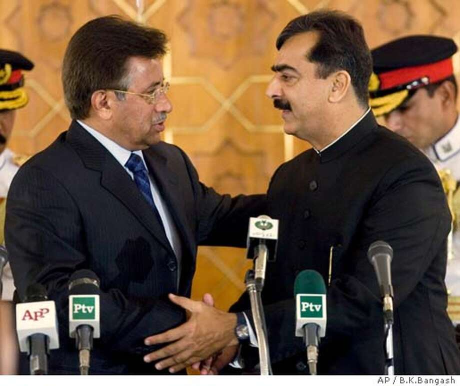 Pakistan's President Pervez Musharraf, left, greets newly-elected Prime Minister Yousaf Raza Gilani after his swearing in ceremony at the presidential palace in Islamabad, Pakistan on Tuesday, March 25, 2008. Musharraf swore in the loyalist of slain ex-leader Benazir Bhutto as prime minister Tuesday, while American envoys held talks with Pakistan's new leaders.(AP Photo/B.K.Bangash) Photo: B.K.Bangash