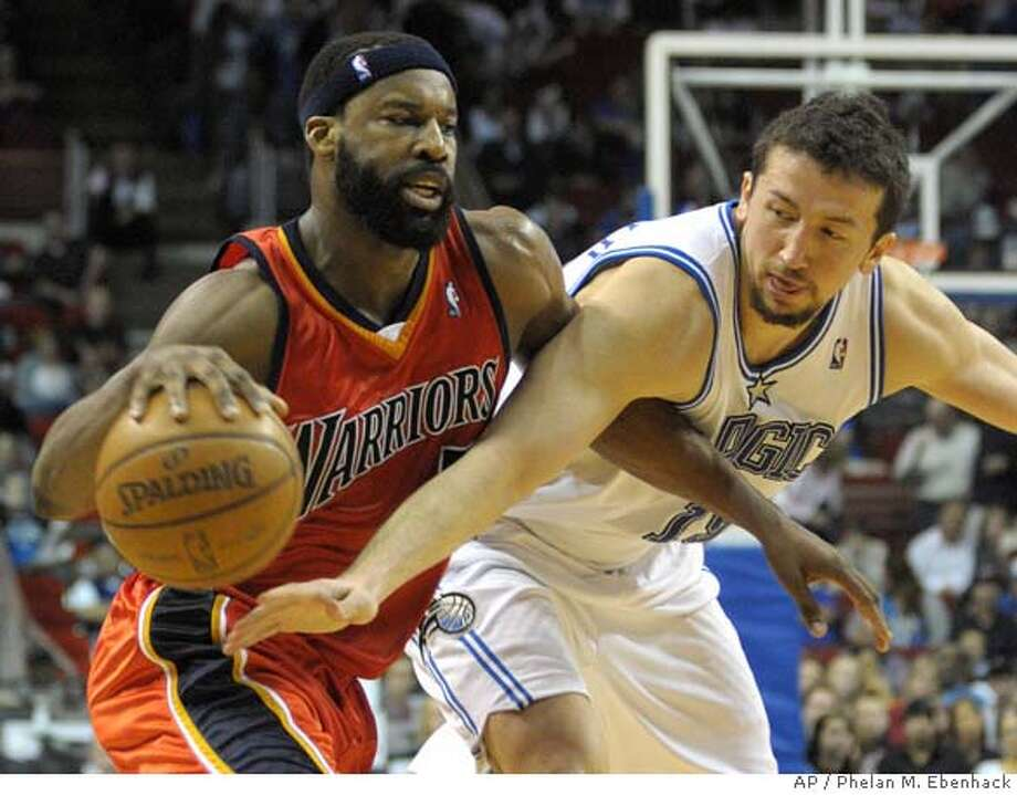 ###Live Caption:Golden State Warriors guard Baron Davis, left, is fouled by Orlando Magic forward Hedo Turkoglu, of Turkey, while driving to the basket during the second half of an NBA basketball game in Orlando, Fla., Saturday, March 8, 2008. The Warriors won, 104-95. (AP Photo/Phelan M. Ebenhack)###Caption History:Golden State Warriors guard Baron Davis, left, is fouled by Orlando Magic forward Hedo Turkoglu, of Turkey, while driving to the basket during the second half of an NBA basketball game in Orlando, Fla., Saturday, March 8, 2008. The Warriors won, 104-95. (AP Photo/Phelan M. Ebenhack)###Notes:Baron Davis, Hedo Turkoglu###Special Instructions:EFE OUT Photo: Phelan M. Ebenhack