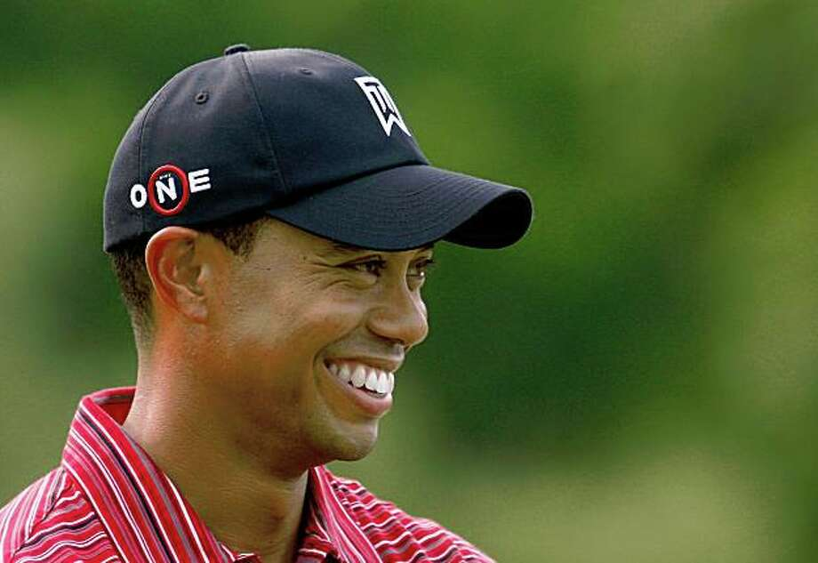 DUBLIN, OH - JUNE 07: Tiger Woods waits on the 18th green after a one-stroke victory at the Memorial Tournament at the Muirfield Village Golf Club on June 7, 2009 in Dublin, Ohio. (Photo by Scott Halleran/Getty Images) Ran on: 06-09-2009 In his latest display of genius, Tiger Woods stormed to another victory Sunday. Photo: Scott Halleran, Getty Images