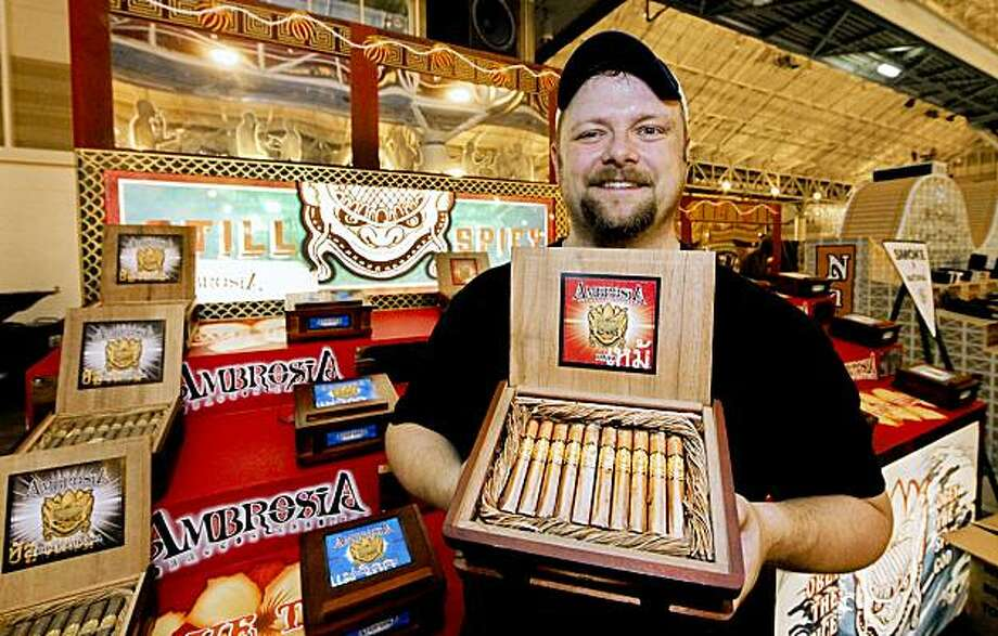 Michael Staiber of Drew Estate shows a box of 4 x 38 Kaya cigars at the 77th annual trade show of the International Premium Cigar & Pipe Retailers Association  in New Orleans, Saturday, Aug. 8, 2009.  (AP Photo/Judi Bottoni) Photo: Judi Bottoni, AP