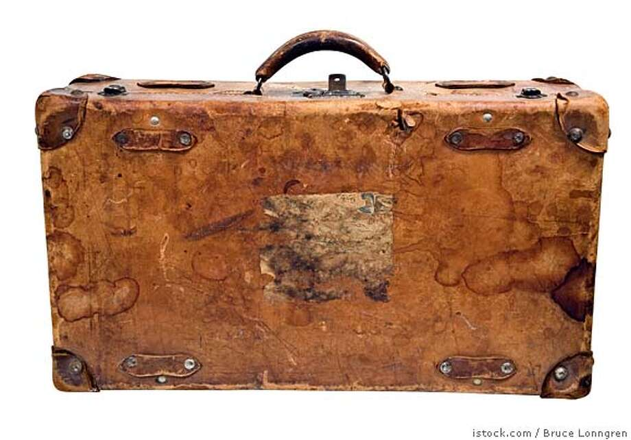 ###Live Caption:suitcase. no caption. one time use only.###Caption History:suitcase. no caption. one time use only.###Notes:###Special Instructions: Photo: Bruce Lonngren