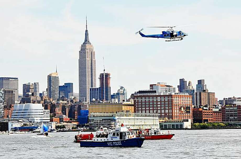 HOBOKEN, NJ - AUGUST 08:  Rescue boats circle the area where a small airplane and helicopter collided over the Hudson River August 8, 2009 in Hoboken, New Jersey. According to reports, a small plane carrying three people, which took off from Teterboro Airport in New Jersey, collided with a helicopter owned by Liberty Tours that was carrying approximately six people. The incident took place over Hudson River inbetween New York and New Jersey just after noon on Saturday.  (Photo by Carl Erwich/Getty Images) Photo: Carl Erwich, Getty Images