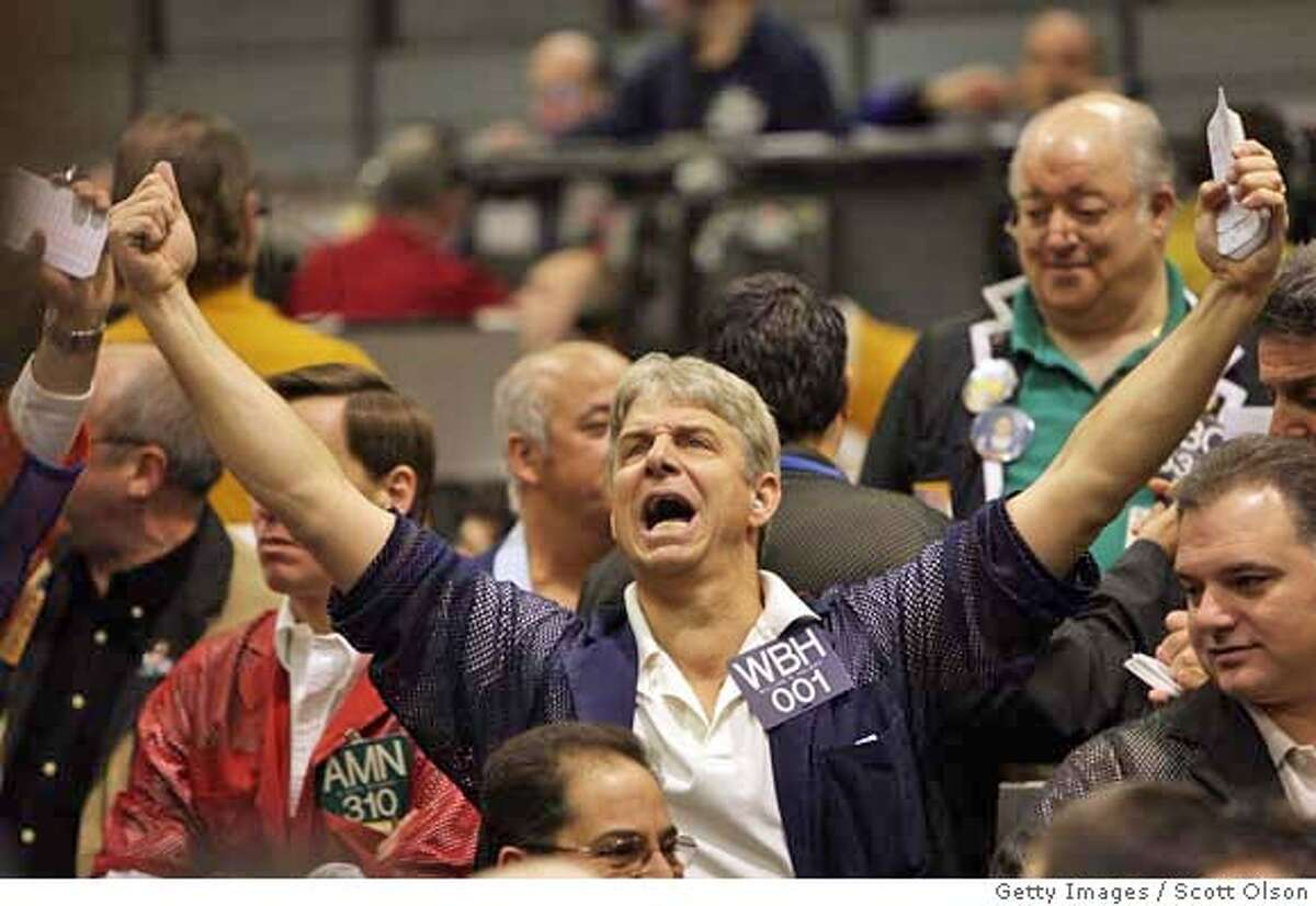 ###Live Caption:CHICAGO - MARCH 17: William Holway signals an offer in the S&P 500 stock index futures pit at the Chicago Mercantile March 17, 2008 in Chicago, Illinois. Stocks plunged today at the market open due in part to news of the near collapse and takeover of Bear Stearns. (Photo by Scott Olson/Getty Images)###Caption History:CHICAGO - MARCH 17: William Holway signals an offer in the S&P 500 stock index futures pit at the Chicago Mercantile March 17, 2008 in Chicago, Illinois. Stocks plunged today at the market open due in part to news of the near collapse and takeover of Bear Stearns. (Photo by Scott Olson/Getty Images)###Notes:Traders At The Chicago Mercantile React To Weekend's Financial News###Special Instructions: