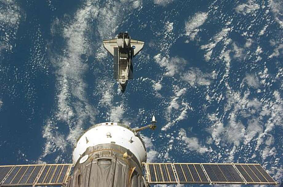 This image provided by NASA shows the space shuttle Endeavour backdropped by a blue and white Earth, taken by a member of the Expedition 20 crew onboard the International Space Station shortly after the shuttle and station began their post-undocking separation on Tuesday July 28, 2009. (AP photo/NASA) Photo: NASA, AP