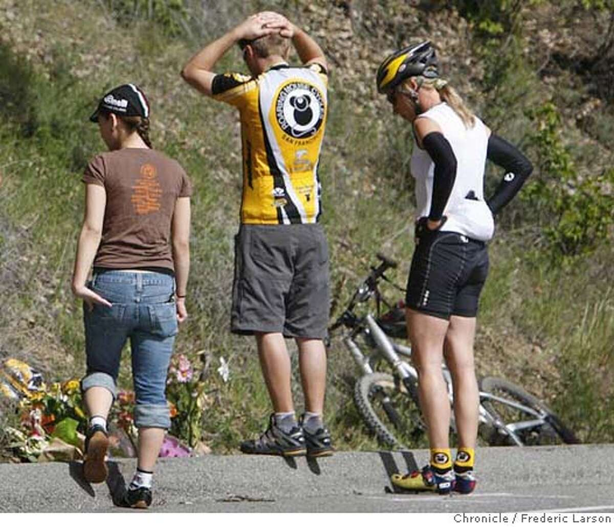 ###Live Caption:Members of the Roaring Mouse Cycling Clug of San Francisco stand by a make shift memorial has was placed at the scene Martch 10, 2008, of where Deputy James Council who was working patrol Sunday morning crossed onto the wrong side of Stevens Canyon Road at 10:25 a.m. and rammed the three southbound bicyclists head-on killing two and injuring the other. 3/10/08 Photo by Frederic Larson / San Francisco Chronicle###Caption History:Members of the Roaring Mouse Cycling Clug of San Francisco stand by a make shift memorial has was placed at the scene Martch 10, 2008, of where Deputy James Council who was working patrol Sunday morning crossed onto the wrong side of Stevens Canyon Road at 10:25 a.m. and rammed the three southbound bicyclists head-on killing two and injuring the other. 3/10/08 Photo by Frederic Larson / San Francisco Chronicle###Notes:###Special Instructions:MANDATORY CREDIT FOR PHOTOG AND SAN FRANCISCO CHRONICLE/NO SALES-MAGS OUT