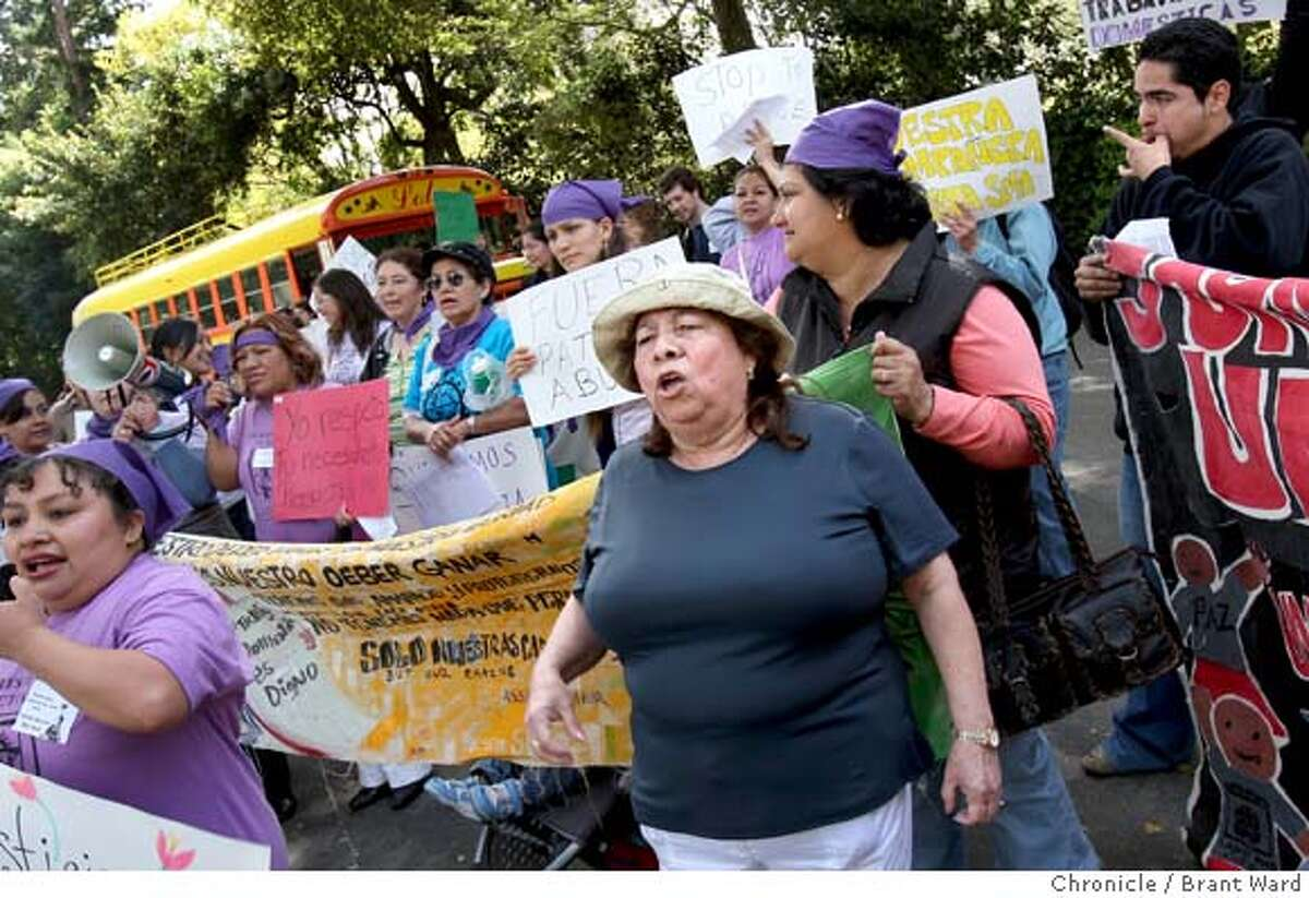 Vilma Serralta, center in light hat, joined in the protest in front of her former employers house Thursday. Vilma Serralta is suing her former employers in Atherton, CA because she says she was overworked and underpaid as a live-in . Photo by Brant Ward / San Francisco Chronicle