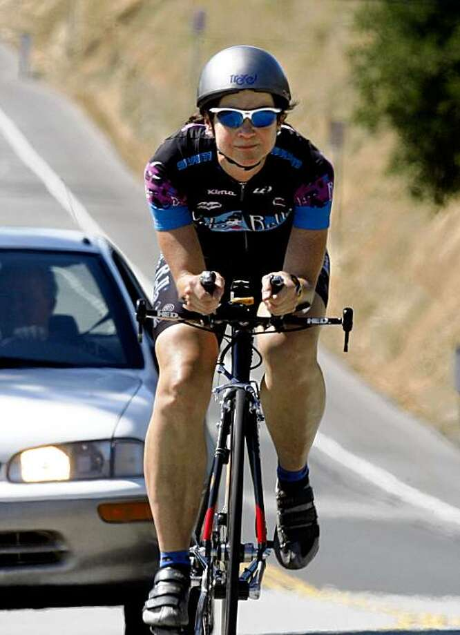 Liz Benishin, 52, is a nurse who does time trial bicycle racing and is riding on Canada Road in San Mateo, Calif.,  on Friday, July 17, 2009. Photo: Liz Hafalia, The Chronicle